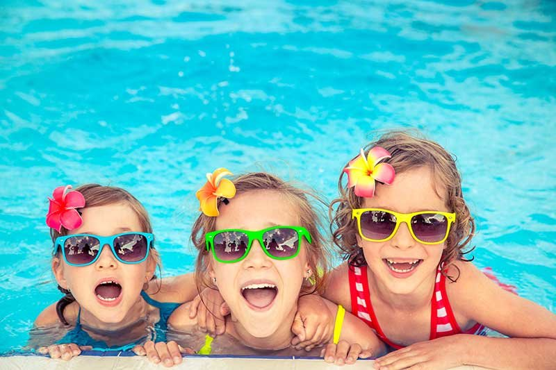 3 adorable girls swimming at Highland Family Aquatic Center in Pinellas Park
