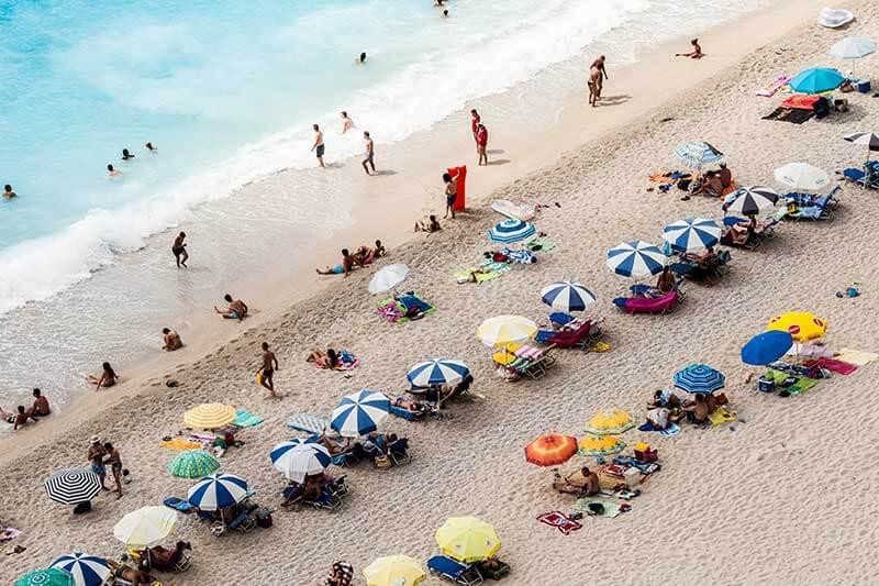 Florida beach goers under umbrellas
