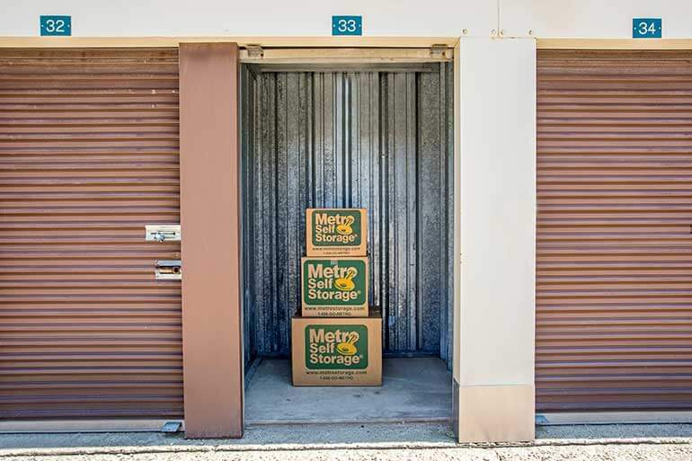 Metro Self Storage moving boxes stacked inside 5X5 storage unit in Round Lake Beach, Florida