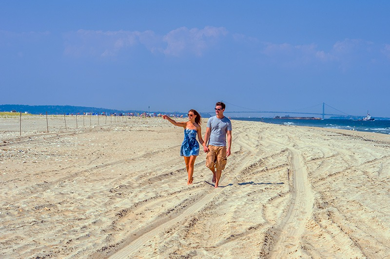 couple walking on New Jersey beach in USA