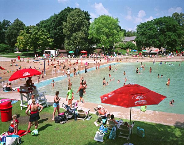 Sunbathers at Centennial Beach near Downtown Naperville