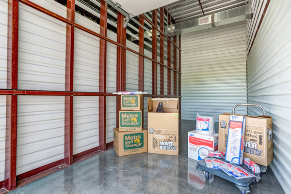 metro self storage drive up storage unit with moving boxes and cart
