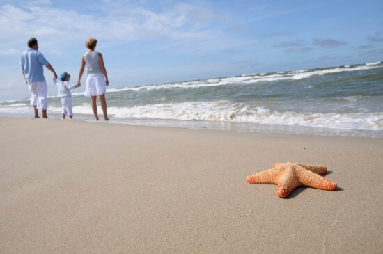 couple walking along Florida beach