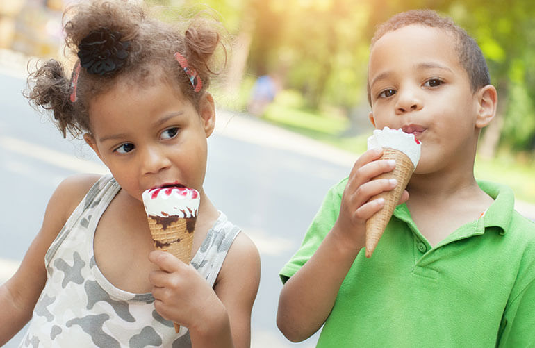 Children eating ice cream cones from The Original Rainbow a south side Chicago neighborhood eatery