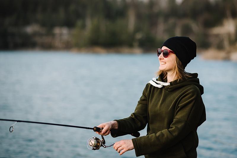 woman fishing on a lake