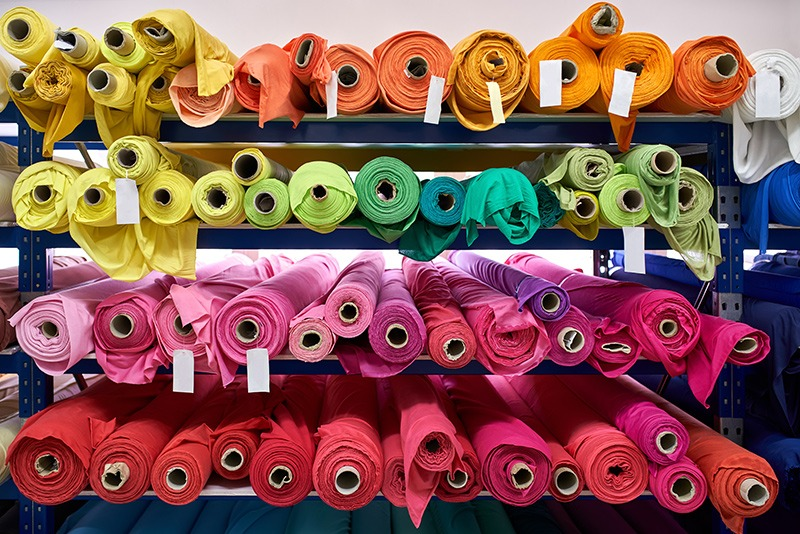 stacks of fabric rolls neatly organized inside a commercial storage unit