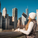 woman looking at Chicago skyline during winter
