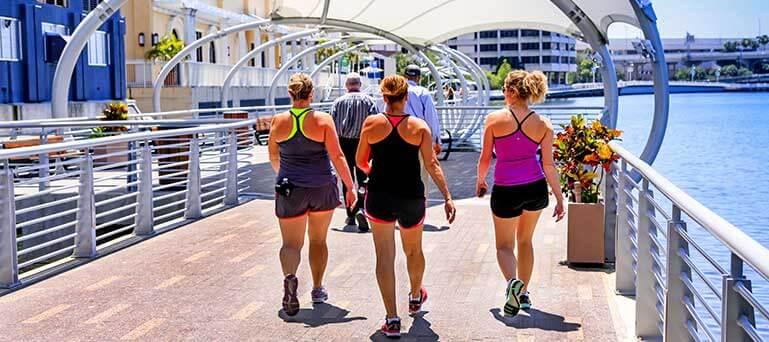 Group of women walking along the Riverwalk in Tampa, Florida