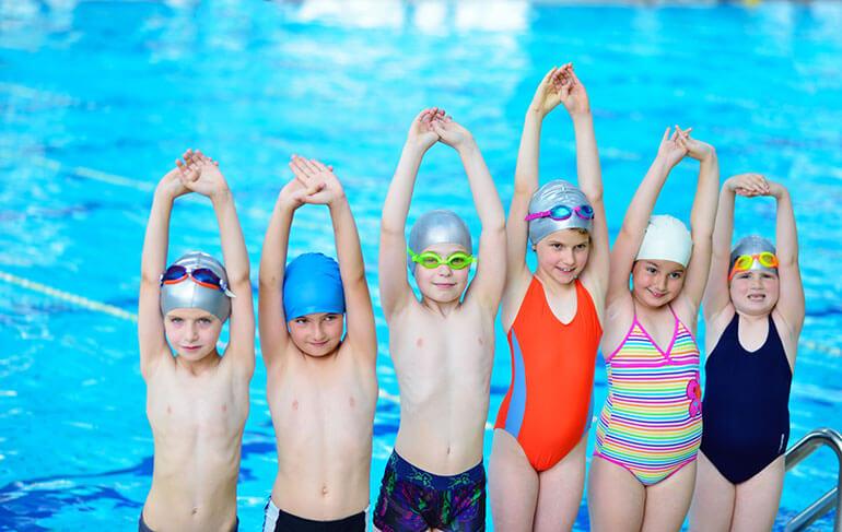 children celebrating at swimming pool moving to Atlanta Suburbs
