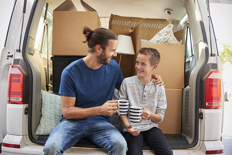 father and young son on moving day