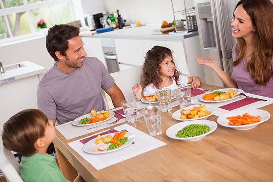 family eating dinner letting the kids know important traditions won't change when they move