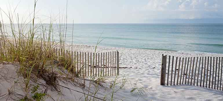Beautiful Florida white sandy beach with fenced opening