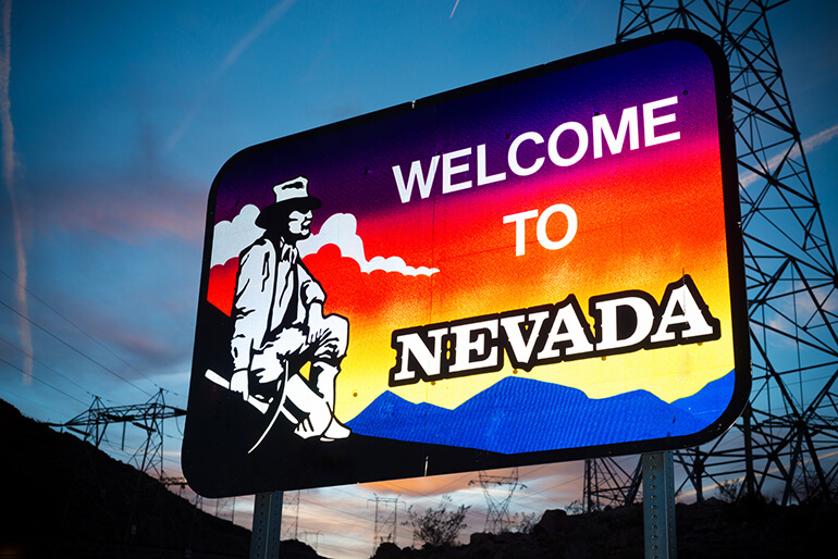 welcome to nevada sign alongside freeway at night moving truck to chicago from san francisco blog metro self storage