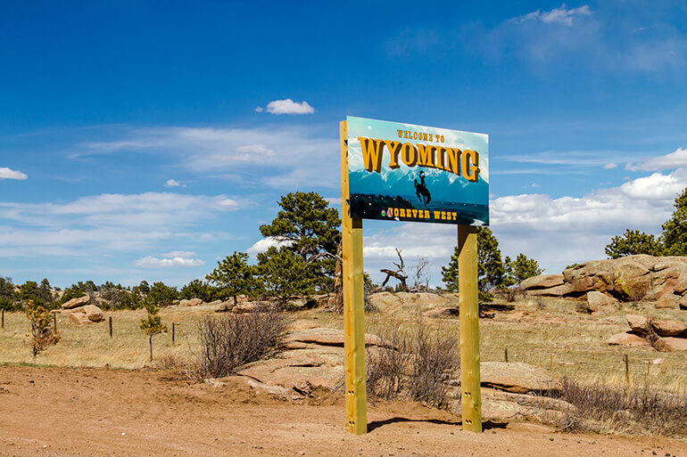 welcome to wyoming sign with desert backdrop metro self storage blog moving truck to chicago blog