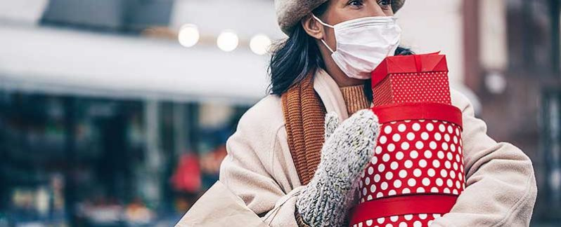 Woman Christmas shopping in Brooklyn during 2020 pandemic