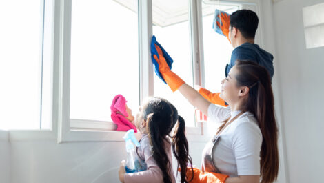 family cleaning the window together